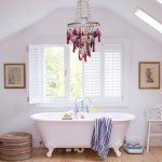 whimsical chandelier in bath from house to home