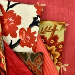 A selection of red decor fabrics