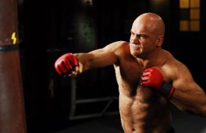 MMA fighter Bas Rutten tests his striking power with MMA gloves
