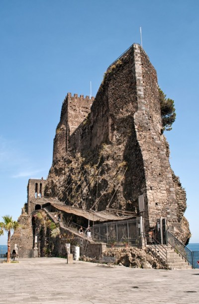 North of Catania in Sicily are a string of coastal castles and fishing villages where volcanic rock from Mt Etna meets the turquoise Ionian sea – like Aci Castello, where a towering rocky cliff is topped by Norman castle - ontheluce.com