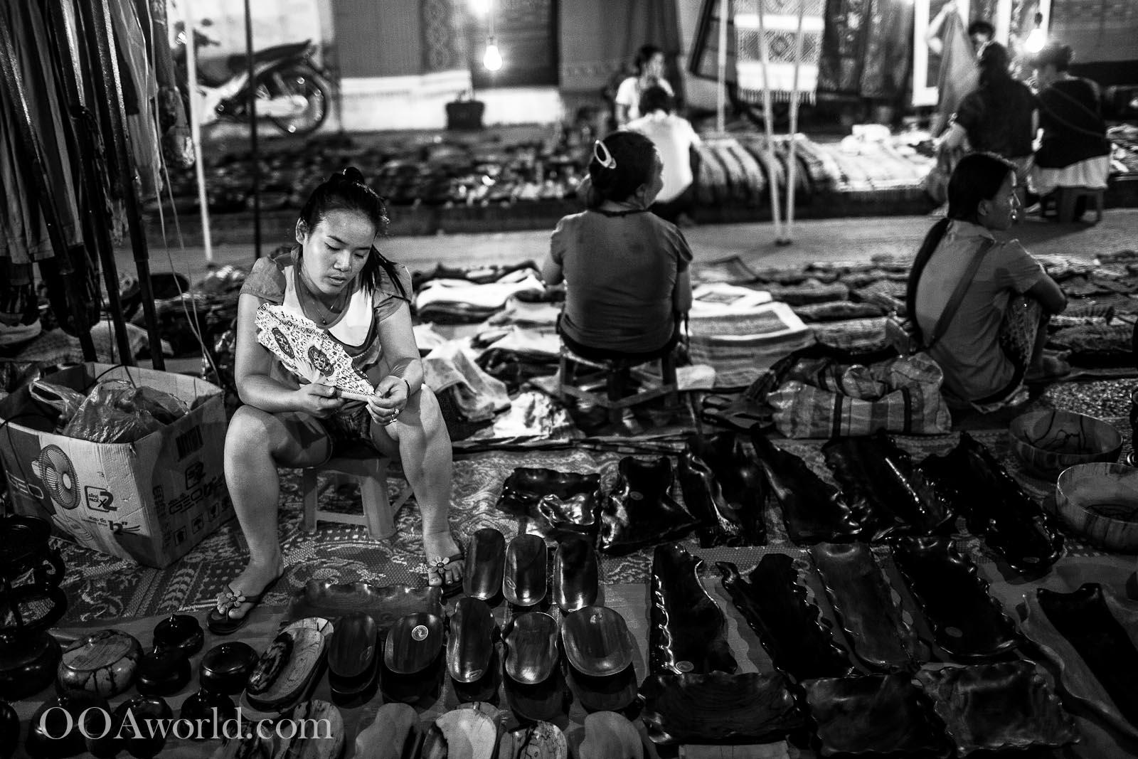 Girl Selling Shoes at the Luang Prabang Market Photo Ooaworld