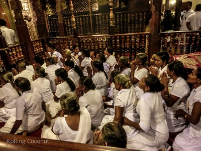 Kandy Temple of the Tooth Women Praying Sri Lanka ooaworld Rolling Coconut Photo Ooaworld