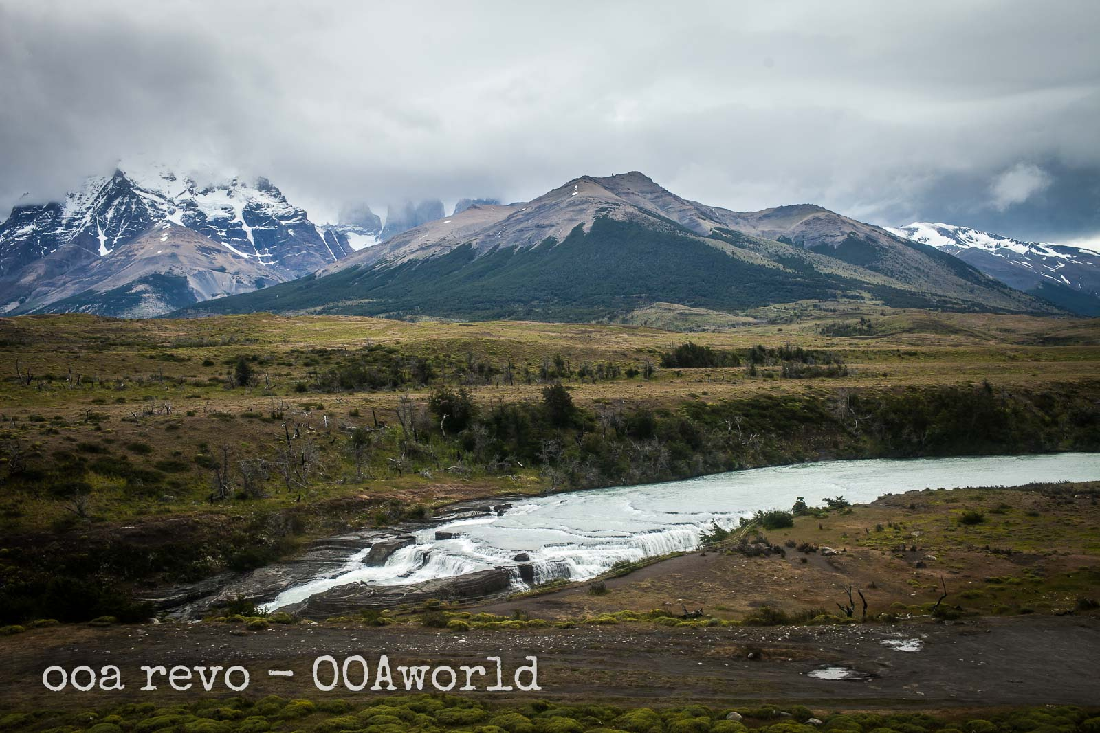 Puerto Natales Bus to Torres del Paine River and Mountains Photo Ooaworld