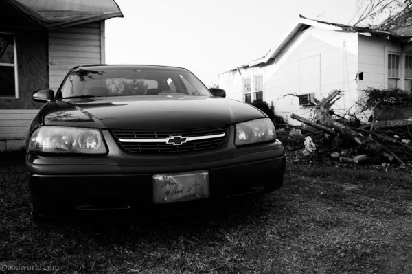 Man of God license plate in the destroyed town of Tuscaloosa