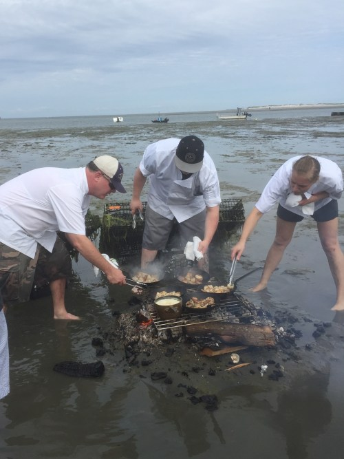 Cooking on fire on wet sand