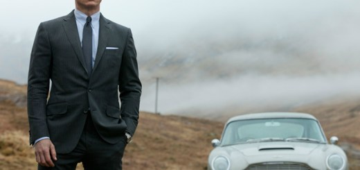 James Bond (Daniel Craig) prepares to confront villain Raoul Silva (Javier Bardem) in the Scottish countryside. Bond is flanked by a classic Aston Martin, a throwback to past 007 films.
