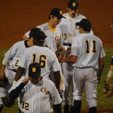Senior Brennan Garcia talks to his team mates after struggling with a couple of batters late in the game.