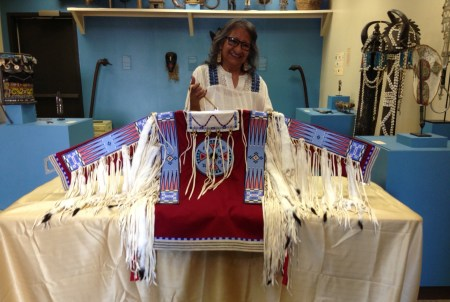 Joyce Growing Thunder Fogarty with her newest Assiniboine shirt, at the Coe Foundation. Photo: Laura Grimes