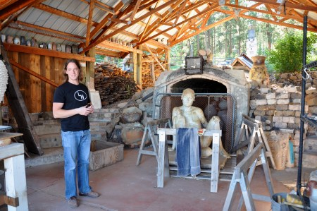 LaBar at the LH Project Toadagama kiln with work by other artists in the background.