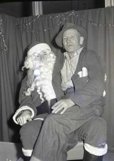 Santa and friend, both anonymous, ca. 1950s/60s. Photo: Earnest Walter Rollins