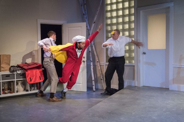 Rolland Walsh, left, dispenses with the caped pizza delivery man, played by Chip Sherman, as Leif Norby looks on in Third Rail Rep's 'Mr Kolpert'/Owen Carey