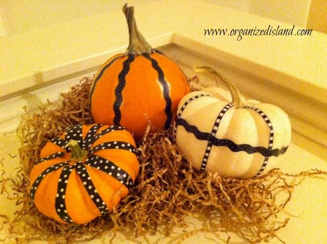 Decorating-pumpkins-during-fall