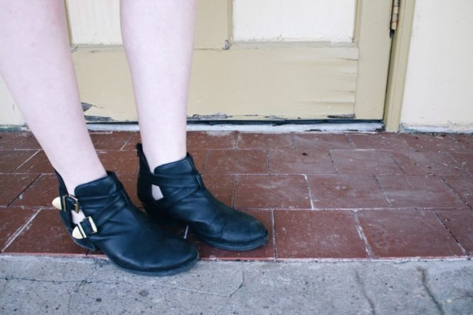 Coachella Inspired. Close up image of the gold buckles and cutouts on the black booties.