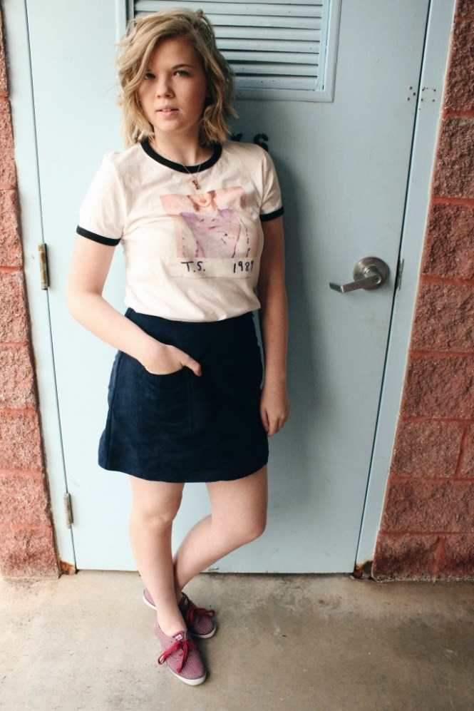 Taylor Swift Tee. Modeling a Taylor Swift concert tee shirt with a blue suede skirt and polka dot keds.