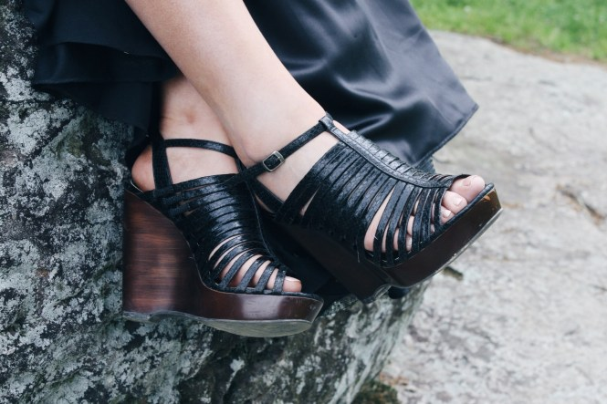 Prom. Close up image of the black and brown Steve Madden wedges.