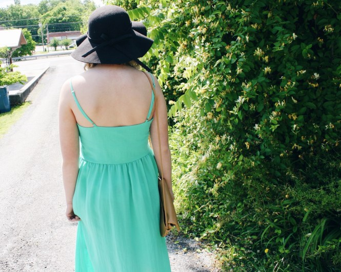"This Dress is ""Mint"" For Summer. Modeling a mint green, midi style dress, floppy hat, beige cross body, and Giving Key necklace."