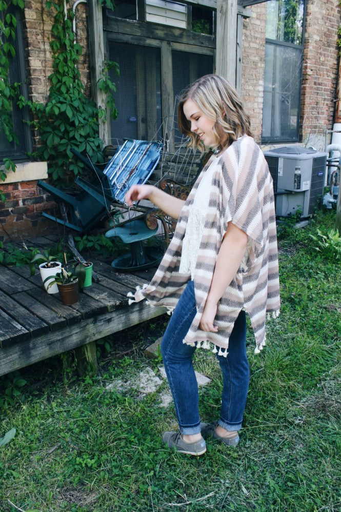 Mix & Match. Modeling a striped poncho, boyfriend jeans, and Toms.