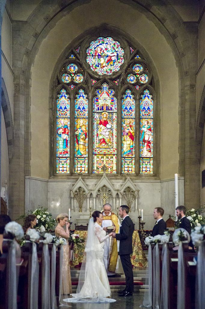 Bride and groom at wedding ceremony exchanging rings
