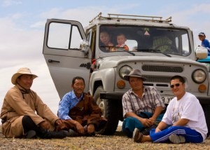 Shat (on the right) and his friends watch Naadam