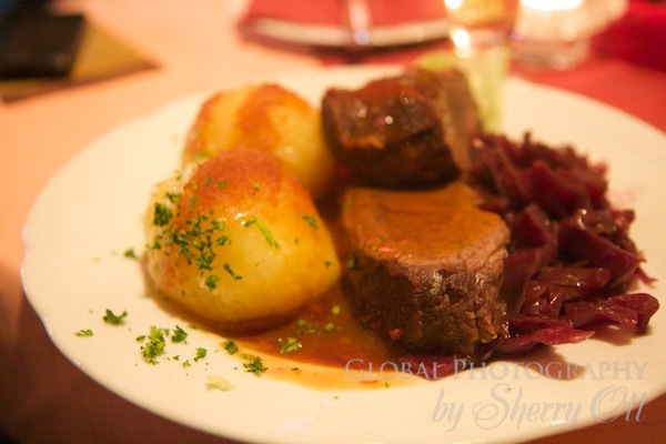 Sauerbraten, red cabbage, and potato dumplings