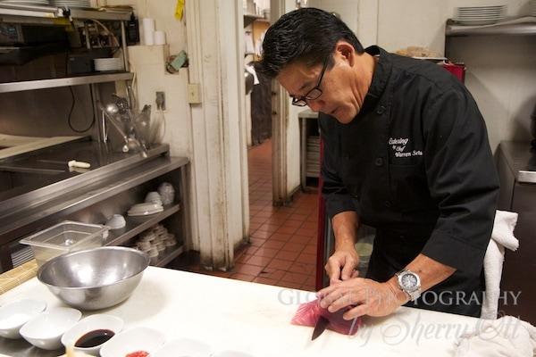 Chef Warren Seta prepares sushi