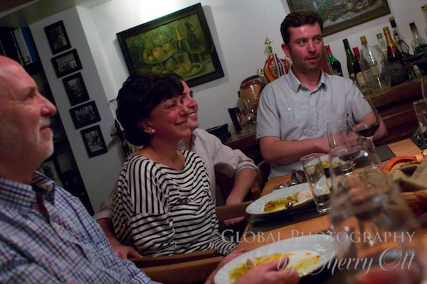 Guests share stories around the communal table