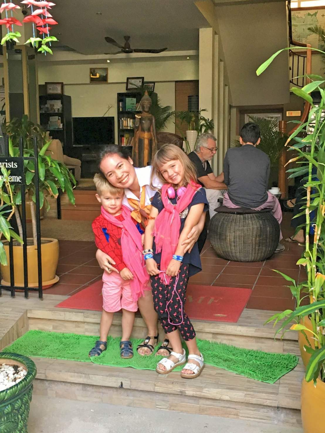 Our kids with their scarves saying goodbye at One Up Banana Hotel, Phnom Penh