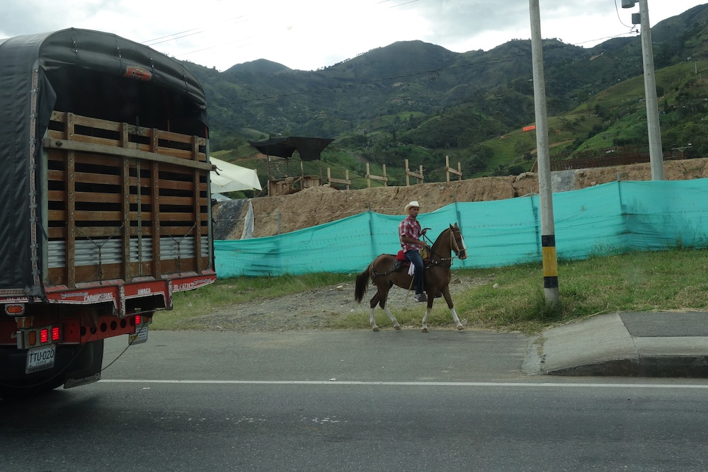 Picture taken while we were waiting to pay toll on the highway! This was not far from Medellin. The Colombia cowboy or llanero. We loved it.