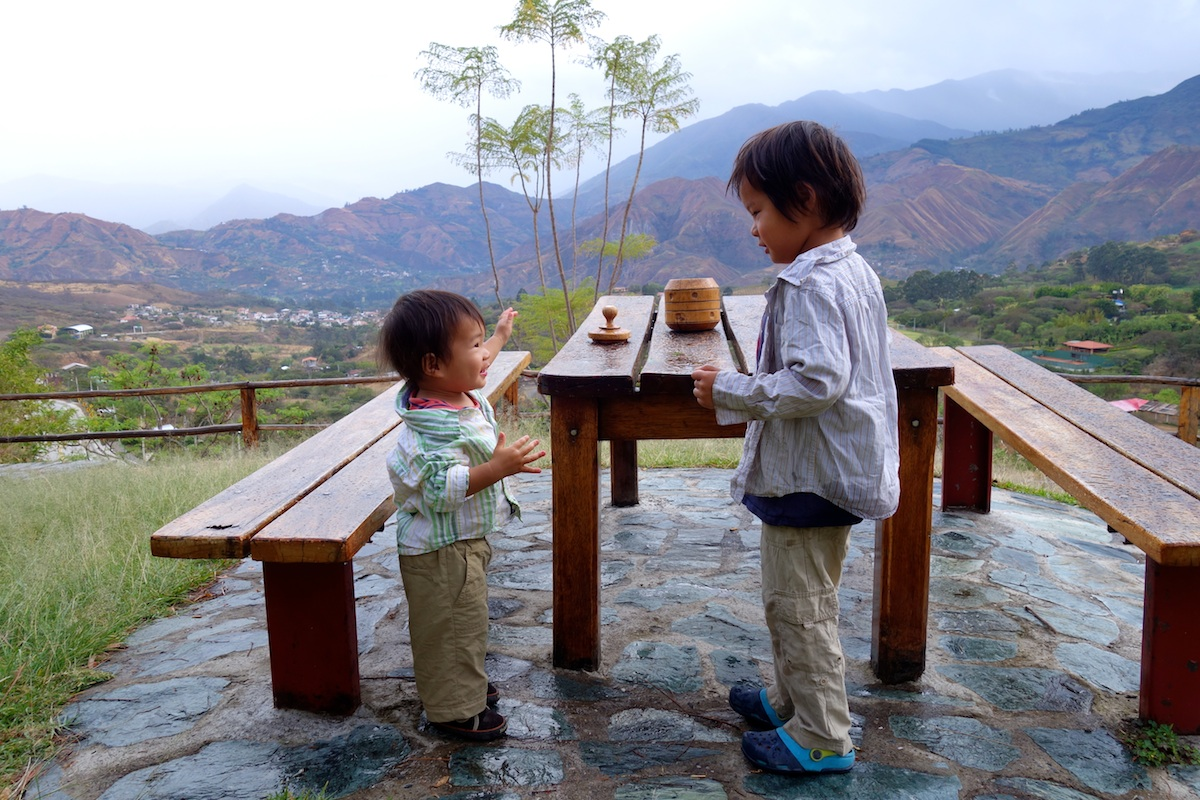 """From the hotel where we camped in Vilcabamba. This was the morning before we left and the kids were splashing themselves with the morning dew. As I tried to tell them no, an elderly gentleman reminded me, """"It is okay. They are simply exploring with their senses."""" Very quintessential Vilcabamba."""