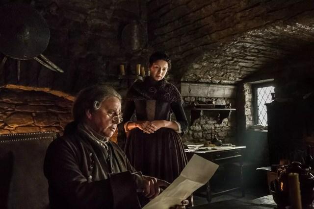 Caitriona Balfe (Claire Randall Fraser) and Frazer Hines (Sir Fletcher Gordon, Governor of Wentworth Prison)
