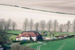 Upper Parsonage Farm at the foot of Butser Hill, the highest point on the South Downs in Hampshire.
