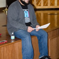 "Jonathan ""Courageous"" Clark leading workshop participants."