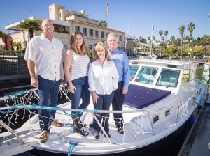 From left, Seacoast Yachts co-owner Brian Coryat, Business Manager Patti Lendick, co-owner Vicki Van Hook and co-owner Bob Nahm stand aboard a yacht in Santa Barbara harbor. (Nik Blaskovich / Business Times photo)