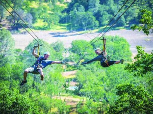 Riders try the Double Barrel, a tandem zip line.