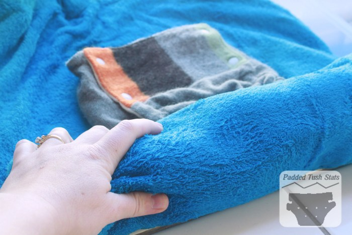 Washing wool cloth diapers tutorial - Rolling up in a towel