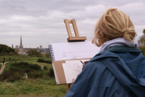 Artist Jack Godfrey draws the skyline from Mousehold Heath at Paint Out Norwich 2015