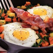 simple paleo breakfast featuring yams, apples and kale...with eggs and bacon