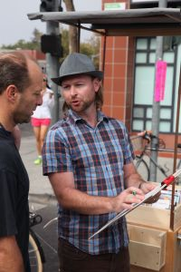 M.A.P artist Peter Foucault at the Cal Ave Farmer's Market. These artists went around town gathering ideas from Palo Altans about public art.