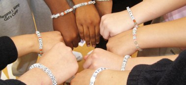 AYP participants make bracelets to remind them of what they learned from yoga and art