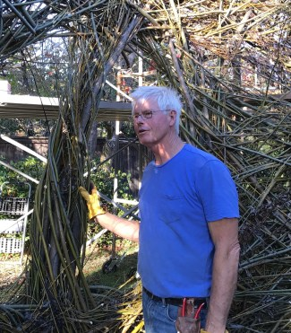 Patrick Doughtery at work on his new sculpture. Photo by Palo Alto Pulse.