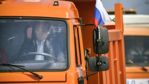 Russian President Vladimir Putin drives a Kamaz truck during a ceremony opening a bridge, which was constructed to connect the Russian mainland with the Crimean Peninsula across the Kerch Strait, May 15, 2018. Alexander Nemenov/Pool via REUTERS