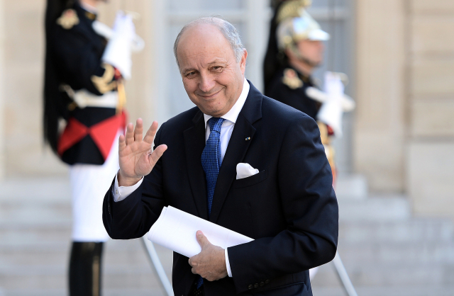 French Foreign Minister Laurent Fabius arrives to attend a dinner  in honour of Chile's president on June 8, 2015, at the Elysee Palace in Paris. Chile's President Michelle Bachelet is on a two-day official visit in France.   AFP PHOTO / STEPHANE DE SAKUTIN