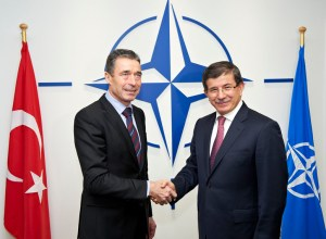 NATO Secretary General Anders Fogh Rasmussen shakes hands with the Minister of Foreign Affairs of Turkey, Ahmet Davutoglu