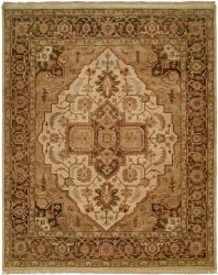Brown Border with Ivory Medallion and Tan Field. Light Blue Accents area rug