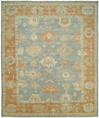 Faded Blue Field with Light Rust Border area rug