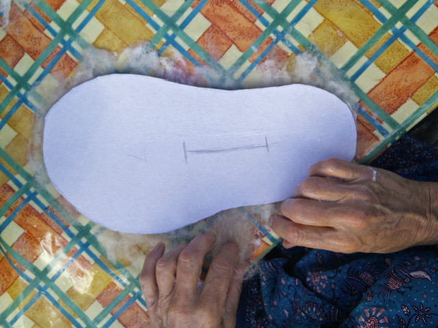 Hand felted slippers: Turning over the template