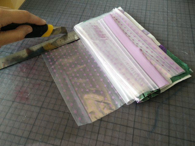 Cutting open the plastic sleeves