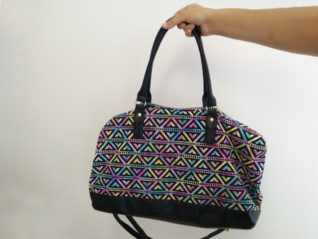 A bag decorated with sharpies and alcohol