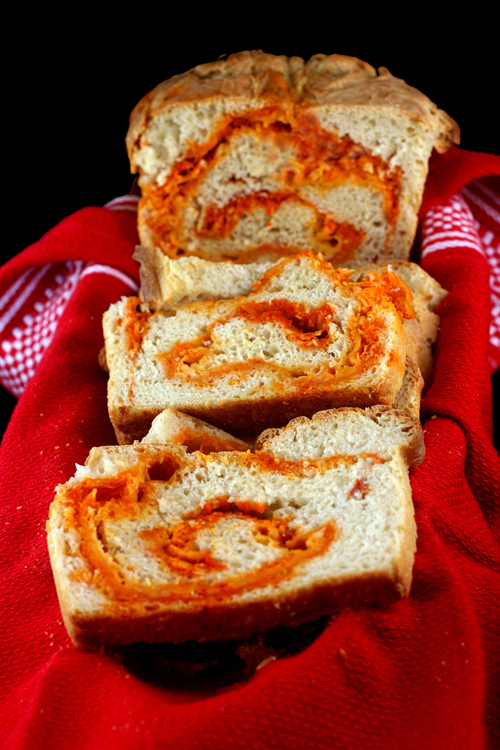 Sriracha Cheddar Pepper Jack Swirl Bread. Crusty on the outside, tender on the inside, with a swirl of Sriracha, Cheddar Cheese and Pepper Jack Cheese.