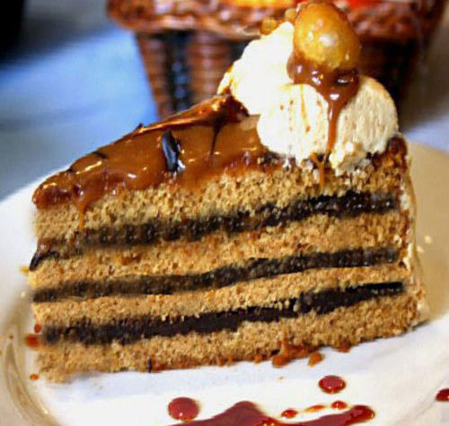Tender and Moist Caramel Cake with Caramel Brown Butter Frosting and Hot fudge Filling. A Gluten-Free version too!